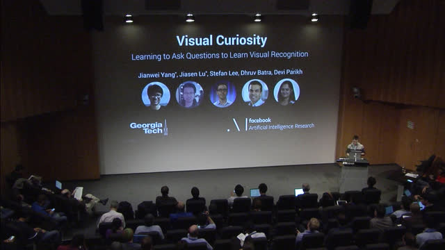 Visual Curiosity: Learning to Ask Questions to Learn Visual
